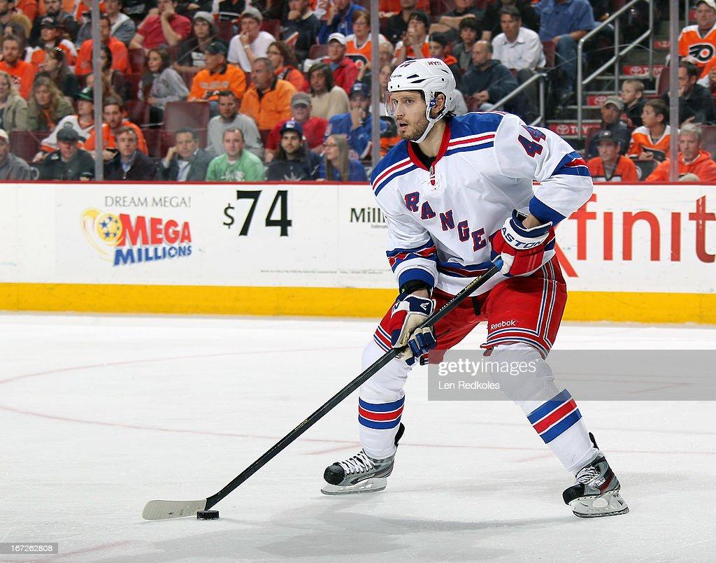 Steve Eminger of the New York Rangers skates the puck against the Philadelphia Flyers on April 16 2013 at the Wells Fargo Center in Philadelphia...