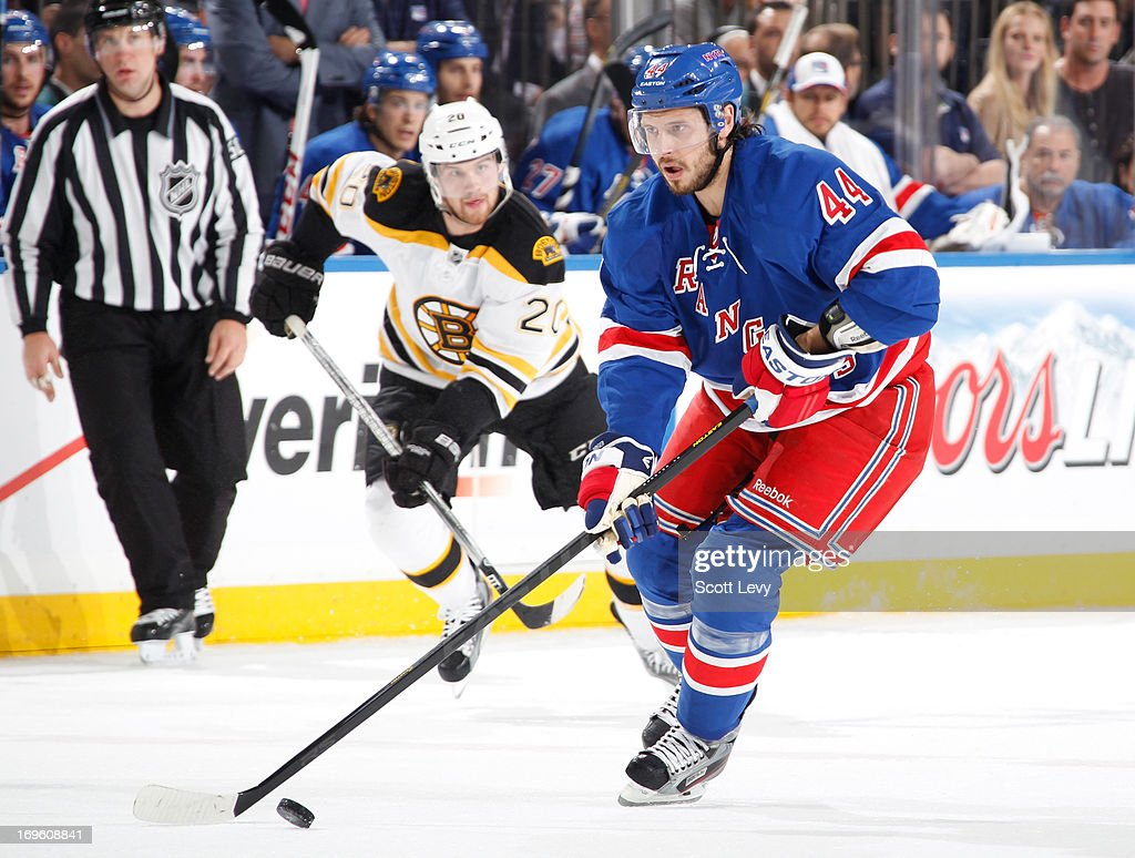 Steve Eminger of the New York Rangers skates with the puck against the Boston Bruins in Game Four of the Eastern Conference Semifinals during the...