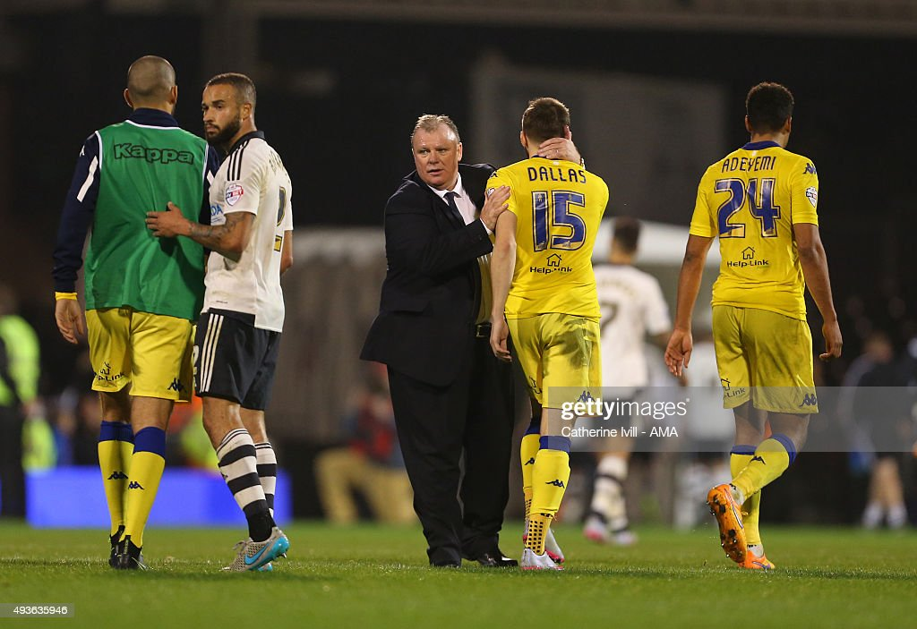 Steve Evans manager of Leeds United congratulates his team at the end of the match after the Sky Bet Championship match between Fulham and Leeds United at Craven Cottage on October 21, 2015 in London, England.