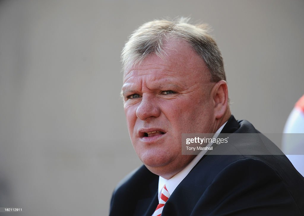 Steve Evans, manager of Rotherham United looks on from the bench during the Sky Bet League One match between Rotherham United and Peterborough United at The New York Stadium on September 28, 2013 in Rotherham, England.