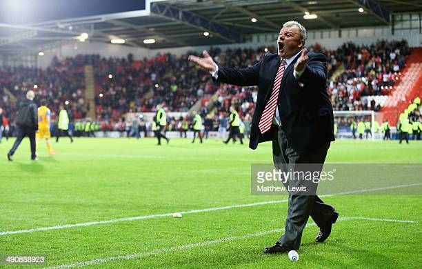 Steve Evans manager of Rotherham United tells the local supporters to get off the pitch during the Sky Bet League One Play Off Semi Final Second Leg...