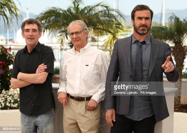 Steve Evets Director Ken Loach and Eric Cantona at a photocall for the film 'Looking for Eric' at the Palais des Festivals in Cannes France during...