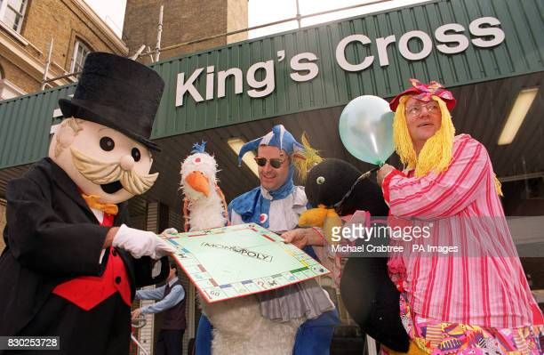 Steve Fingleton and Jon Hyan outside London's King's Cross station to launch Monopoly Live 99 where teams race against the clock to visit as many of...