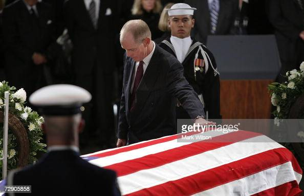 Steve Ford son of former US President Gerald Ford reaches out to touch his casket during funeral services for former US President Gerald Ford in the...