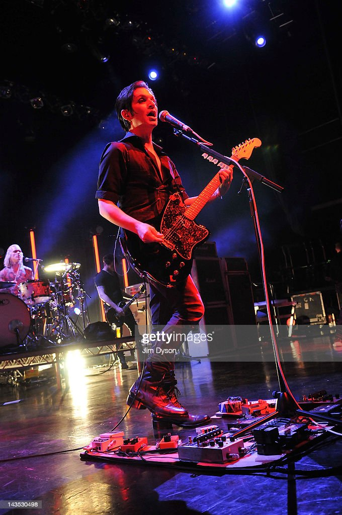 Steve Forrest and <a gi-track='captionPersonalityLinkClicked' href=/galleries/search?phrase=Brian+Molko&family=editorial&specificpeople=540626 ng-click='$event.stopPropagation()'>Brian Molko</a> of Placebo perform live on stage during Sundance London Film & Music Festival at Indigo2 at O2 Arena on April 28, 2012 in London, United Kingdom.