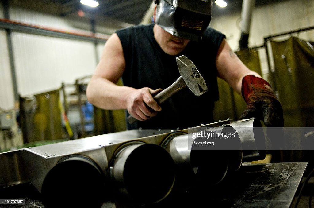 Steve Fossum assembles a ventilation duct at the Giese Manufacturing Co. in Dubuque, Iowa, U.S., on Thursday, Feb. 14, 2013. The U.S. Federal Reserve is schedule to release industrial productions figures on Feb. 15. Photographer: Daniel Acker/Bloomberg via Getty Images