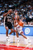 Steve Francis of the Houston Rockets moves the ball against Terry Porter of the San Antonio Spurs during the game on November 5 1999 at Compaq Center...