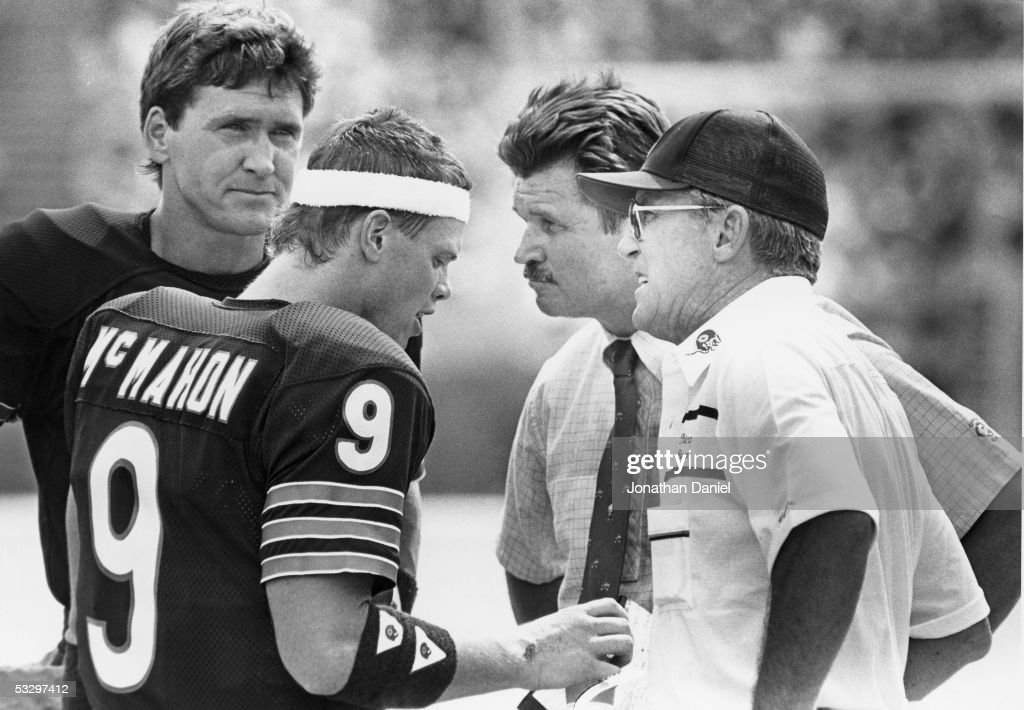 Steve Fuller Jim McMahon head coach Mike Ditka and offensive coordinator Ed Hughes talk on the sideline during a game in the 1985 season at Soldier...