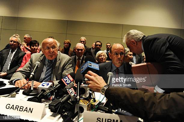 Steve Garban and John Surma prepare to announce that Penn State president Graham Spanier and football head coach Joe Paterno have been fired during...