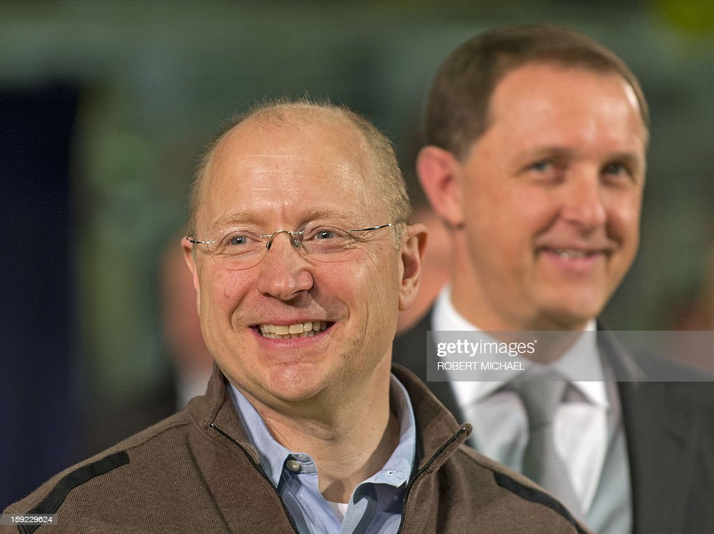 Steve Girsky, Chairman of the Opel Supervisory Board and Thomas Sedran, Vice CEO of German car maker Opel smile as they present a newly fabricated Opel Adam car during the opening ceremony at the Opel plant in Eisenach, eastern Germany on January 10, 2013. The new Opel model will be produced as of January 10, 2013 at the Eisenach Opel plant and is intended to attract young automobile drivers in cities. Opel has already received 16 000 orders for the Adam.