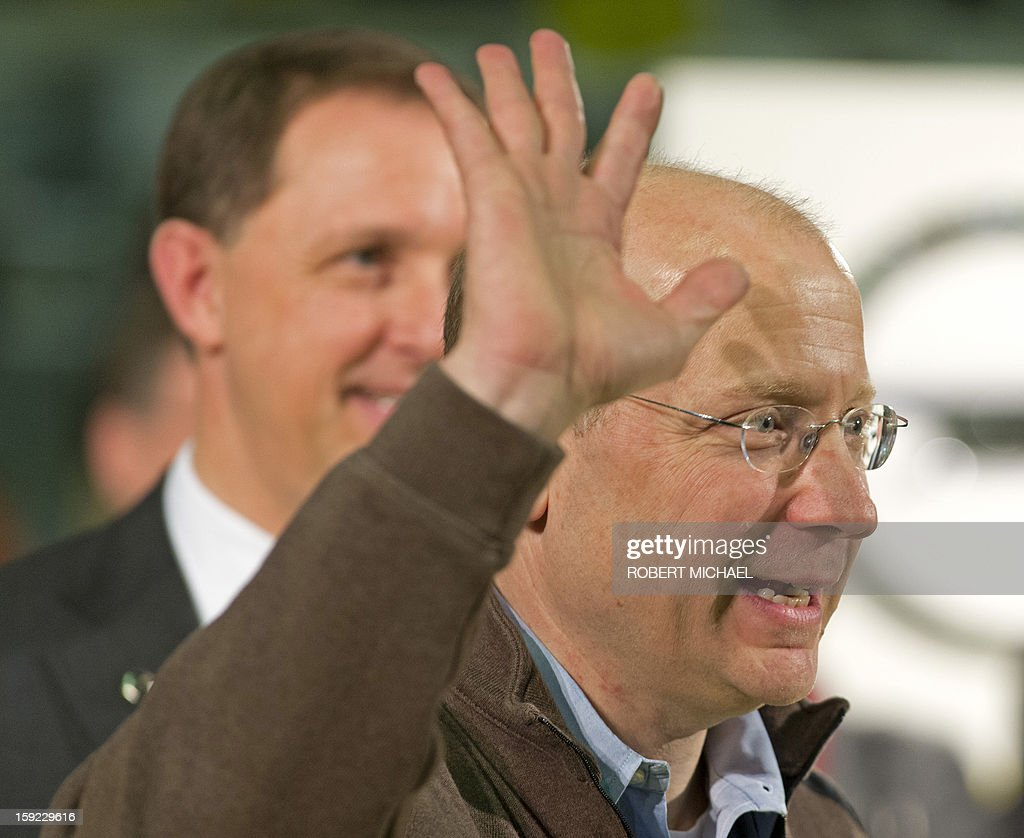 Steve Girsky, Chairman of the Opel Supervisory Board gestures as he and Thomas Sedran, Vice CEO of German car maker Opel as they present a newly fabricated Opel Adam car during the opening ceremony at the Opel plant in Eisenach, eastern Germany on January 10, 2013. The new Opel model will be produced as of January 10, 2013 at the Eisenach Opel plant and is intended to attract young automobile drivers in cities. Opel has already received 16 000 orders for the Adam.