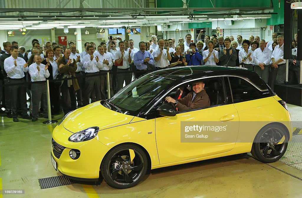 Steve Girsky, General Motors Vice Chairman and head of GM Europe, drives an Opel Adam car from the assembly line as factory workers look on during a celebration to mark the launch of the new Opel compact car at the Opel factory on January 10, 2013 in Eisenach, Germany. Opel employees hope the car will help the compny return to profits after years of sagging sales and the announcement of the Bochum factory closure in 2016.