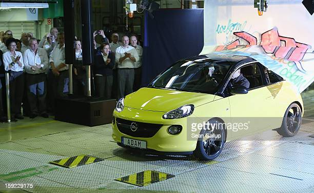 Steve Girsky General Motors Vice Chairman and head of GM Europe drives an Opel Adam car from the assembly line as factory workers look on during a...