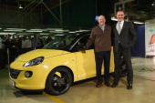 Steve Girsky General Motors Vice Chairman and head of GM Europe and Thomas Sedran Deputy Chairman of Adam Opel AG stand next to an Opel Adam car...
