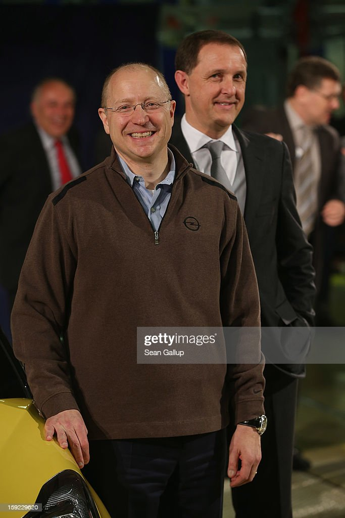 Steve Girsky (L), General Motors Vice Chairman and head of GM Europe, and Thomas Sedran, Deputy Chairman of Adam Opel AG, stand next to an Opel Adam car fresh from the assembly line during a celebration to mark the launch of the new Opel compact car at the Opel factory on January 10, 2013 in Eisenach, Germany. Opel employees hope the car will help the compny return to profits after years of sagging sales and the announcement of the Bochum factory closure in 2016.