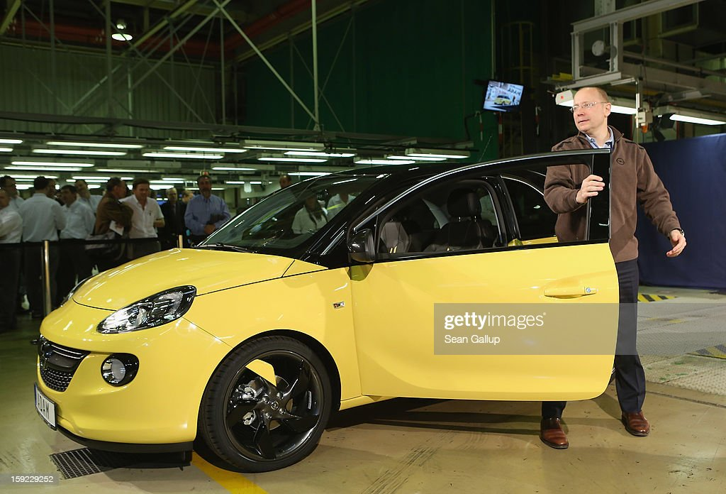 Steve Girsky, General Motors Vice Chairman and head of GM Europe, stands next to an Opel Adam car fresh from the assembly line as factory workers look on during a celebration to mark the launch of the new Opel compact car at the Opel factory on January 10, 2013 in Eisenach, Germany. Opel employees hope the car will help the compny return to profits after years of sagging sales and the announcement of the Bochum factory closure in 2016.