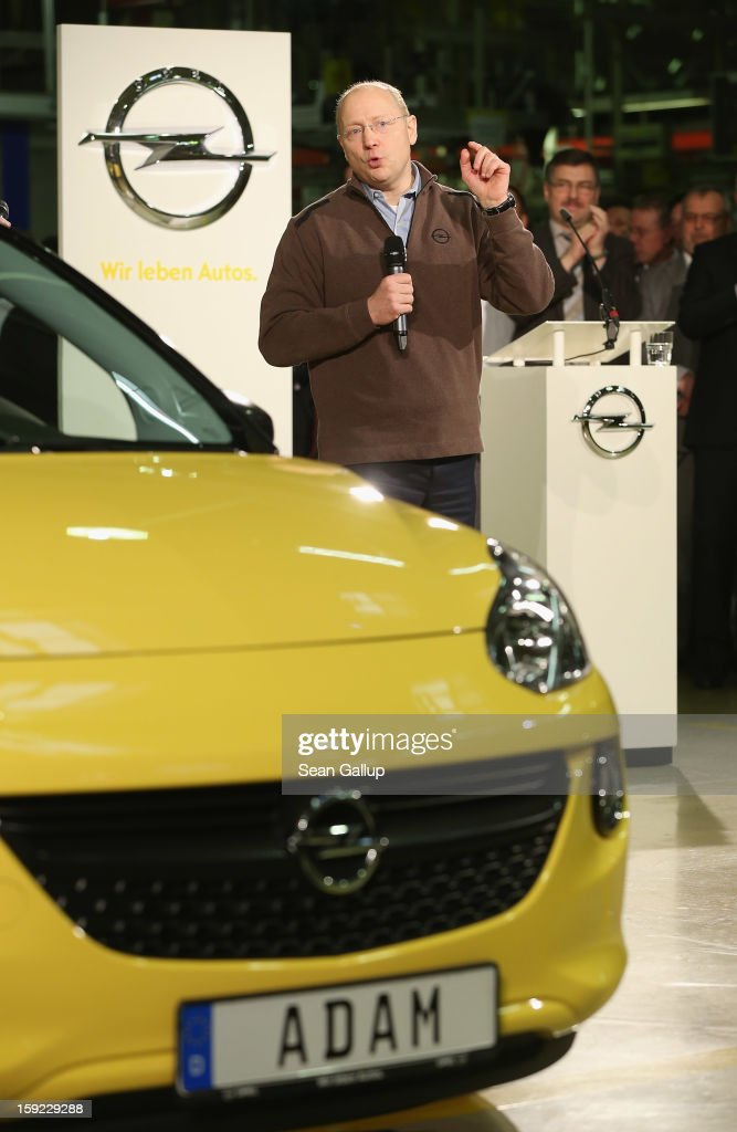 Steve Girsky, General Motors Vice Chairman and head of GM Europe, speaks next to an Opel Adam car fresh from the assembly line during a celebration to mark the launch of the new Opel compact car at the Opel factory on January 10, 2013 in Eisenach, Germany. Opel employees hope the car will help the compny return to profits after years of sagging sales and the announcement of the Bochum factory closure in 2016.