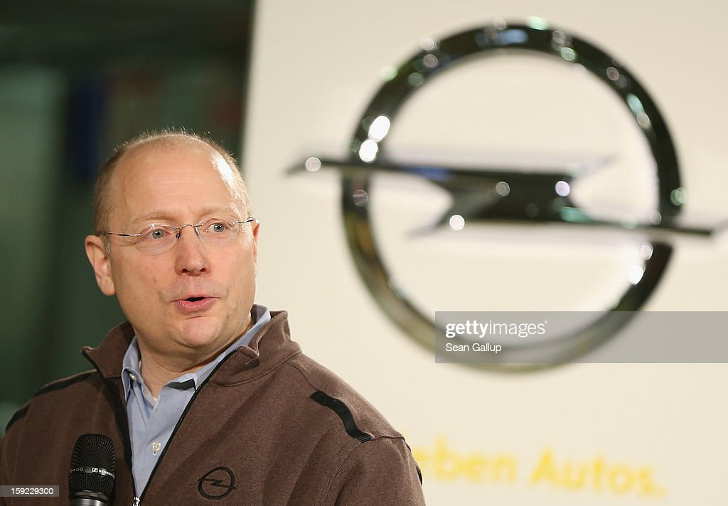 Steve Girsky, General Motors Vice Chairman and head of GM Europe, speaks Opel logo during a celebration to mark the launch of the new Opel Adam compact car at the Opel factory on January 10, 2013 in Eisenach, Germany. Opel employees hope the car will help the compny return to profits after years of sagging sales and the announcement of the Bochum factory closure in 2016.