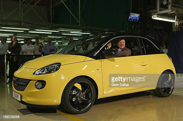 Steve Girsky General Motors Vice Chairman and head of GM Europe sits in an Opel Adam car fresh from the assembly line as factory workers look on...