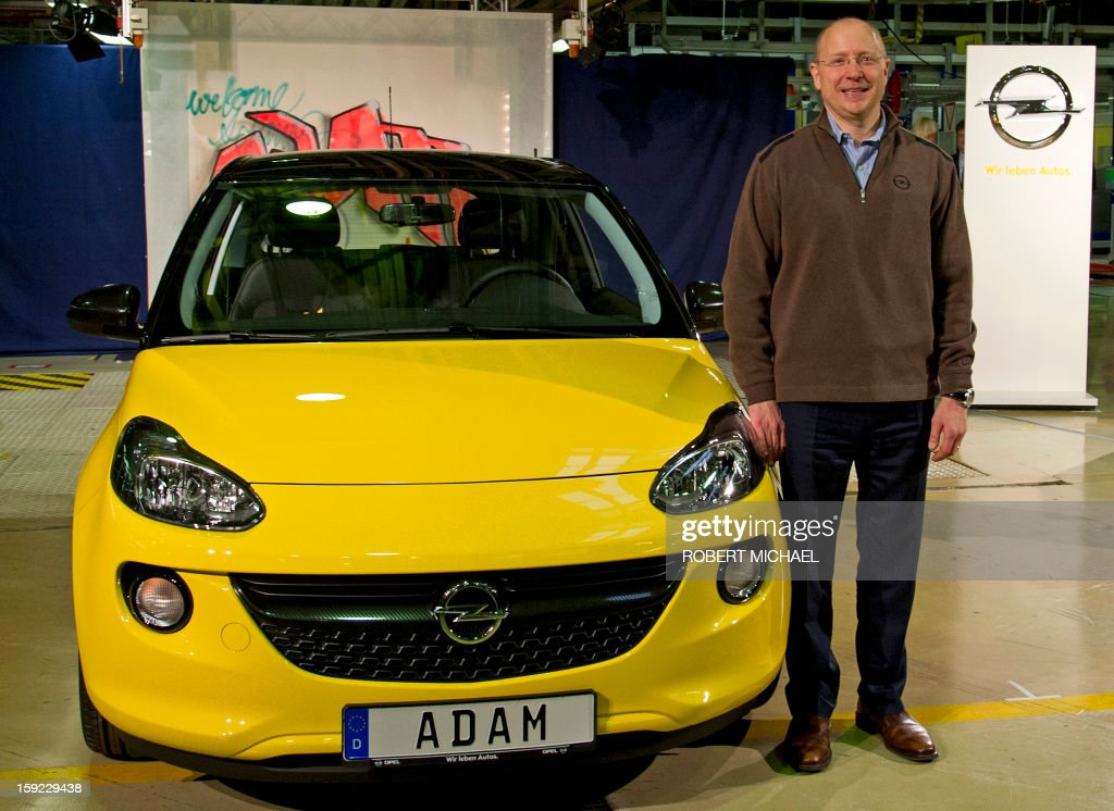 Steve Girsky, GM Vice Chairman, interim President of GM Europe and Chairman of the Opel Supervisory Board, presents a newly fabricated Opel Adam car during the opening ceremony at the Opel plant in Eisenach, eastern Germany on January 10, 2013. The new Opel model will be produced as of January 10, 2013 at the Eisenach Opel plant and is intended to attract young automobile drivers in cities. Opel has already received 16 000 orders for the Adam.