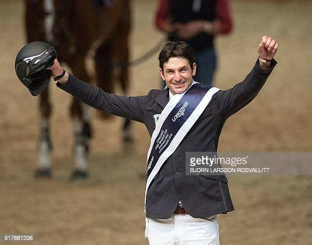 Steve Guerdat of Switzerland celebrates winning the Longines FEI World Cup Jumping Final event of the Gothenburg Horse Show at Scandinavium Arena in...