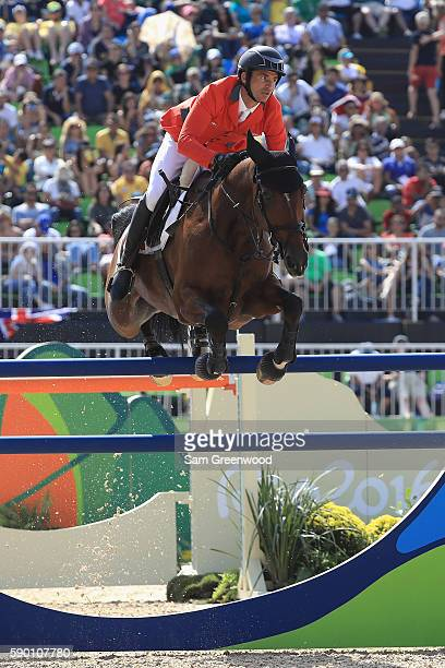 Steve Guerdat of Switzerland rides Nino Des Buissonnets during the Team Jumping on Day 11 of the Rio 2016 Olympic Games at the Olympic Equestrian...