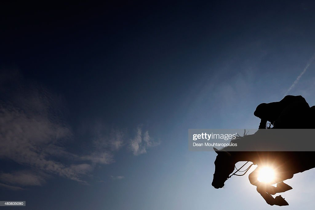 <a gi-track='captionPersonalityLinkClicked' href=/galleries/search?phrase=Steve+Guerdat&family=editorial&specificpeople=2304249 ng-click='$event.stopPropagation()'>Steve Guerdat</a> of Switzerland riding Kavalier competes in the Class 02 CSI5* 1.50/1.55m Against the Clock with Jump-Off during the Longines Global Champions Tour held at Stal Tops on August 13, 2015 in Valkenswaard, Netherlands.