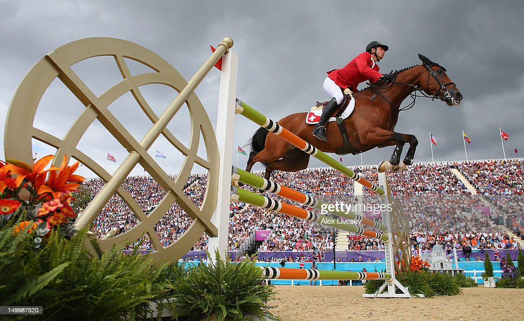 <a gi-track='captionPersonalityLinkClicked' href=/galleries/search?phrase=Steve+Guerdat&family=editorial&specificpeople=2304249 ng-click='$event.stopPropagation()'>Steve Guerdat</a> of Switzerland wins Gold riding Nino Des Buissonnets in the Individual Jumping on Day 12 of the London 2012 Olympic Games at Greenwich Park on August 8, 2012 in London, England.