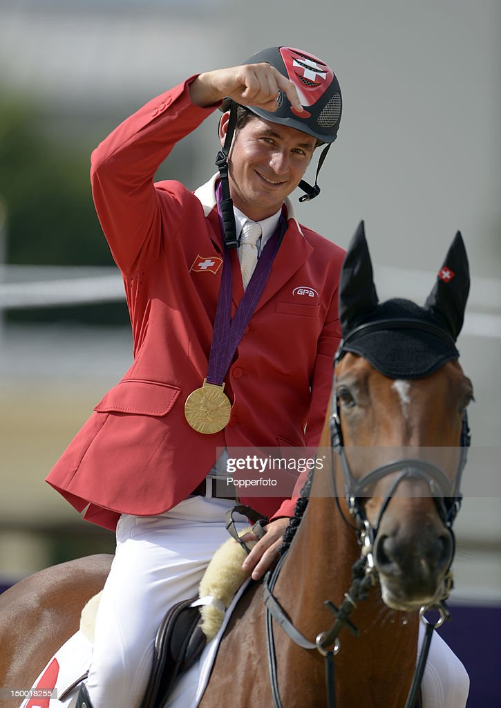 <a gi-track='captionPersonalityLinkClicked' href=/galleries/search?phrase=Steve+Guerdat&family=editorial&specificpeople=2304249 ng-click='$event.stopPropagation()'>Steve Guerdat</a> of Switzerland with his Gold medal after winning the Individual Jumping on Day 12 of the London 2012 Olympic Games at Greenwich Park on August 8, 2012 in London, England.