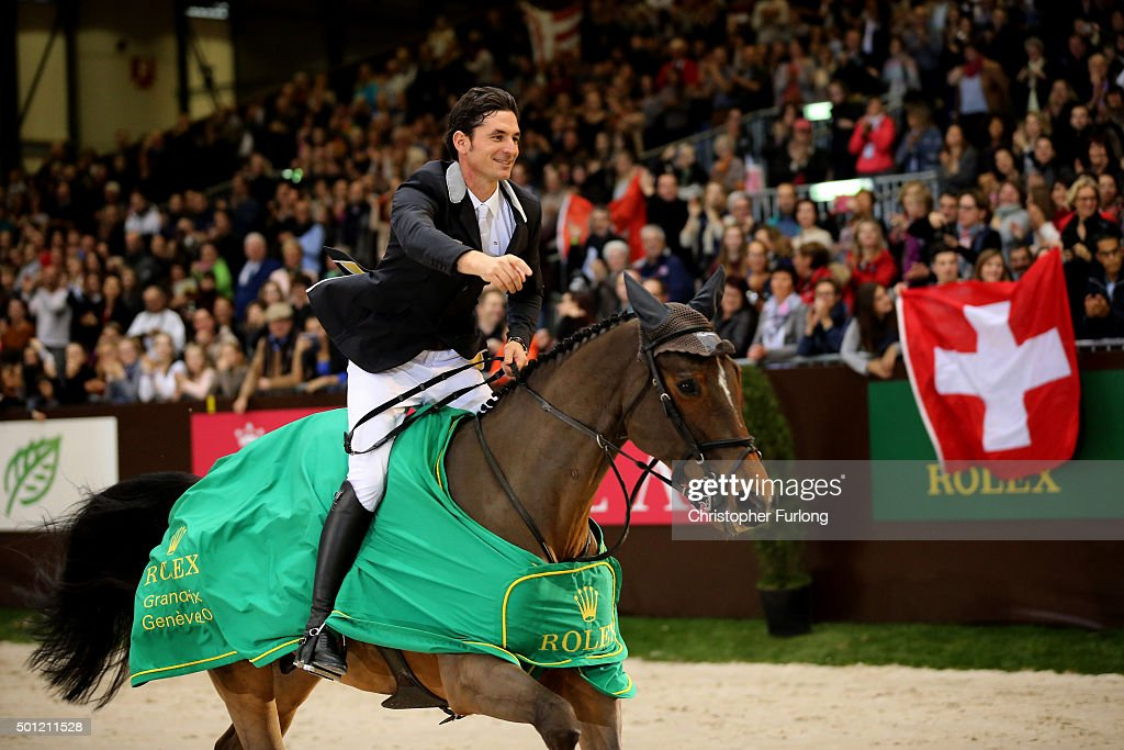 <a gi-track='captionPersonalityLinkClicked' href=/galleries/search?phrase=Steve+Guerdat&family=editorial&specificpeople=2304249 ng-click='$event.stopPropagation()'>Steve Guerdat</a> riding Nino des Buissonnets celebrates winning the Rolex Grand Slam of Show Jumping at Palexpo on December 13, 2015 in Geneva, Switzerland.