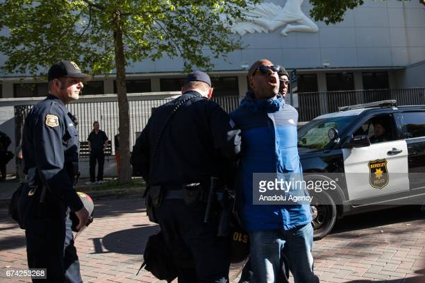 Steve Hall is arrested during a proDonald Trump rally at Martin Luther King Jr Civic Center Park in Berkeley California on April 27 2017 The rally...
