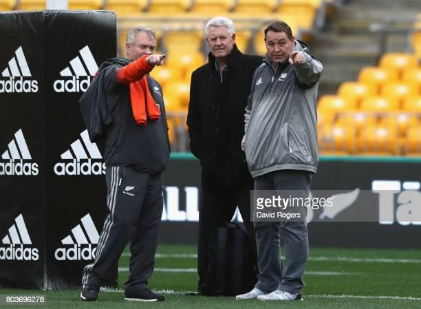 Steve Hansen the All Black head coach talks to NZR CEO Steve Tew and All Black selector Grant Fox during the New Zealand All Blacks Captain's Run at...