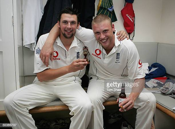 Steve Harmison and Andrew Flintoff of England celebrate in the changing room during day five of the Fifth npower Ashes Test match between England and...