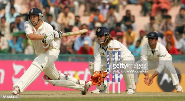 Steve Harmison of England gets ready to reverse sweep watched by India's Mahendra Singh Dhoni and Rahul Dravid during the 2nd Test match between...