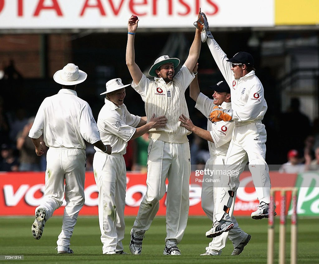 Steve Harmison of England is congratulated by Geraint Jones Michael Vaughan a after catching out Mohammad Ashraful of Bangladesh for 2 runs off the...
