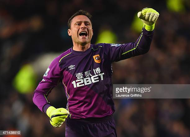 Steve Harper of Hull City celebrates as Michael Dawson scores their first goal during the Barclays Premier League match between Hull City and...