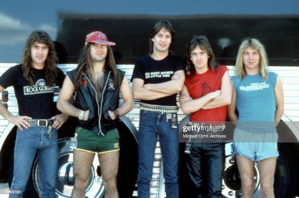 Steve Harris, Bruce Dickinson, Nicko McBrain, Adrian Smith and Dave Murray of the heavy metal band 'Iron Maiden' pose for a portrait in front of their tour bus in September 1983.