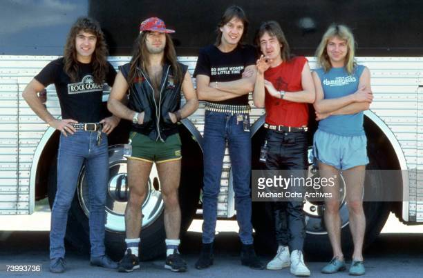 Steve Harris Bruce Dickinson Nicko McBrain Adrian Smith and Dave Murray of the heavy metal band 'Iron Maiden' pose for a portrait in front of their...