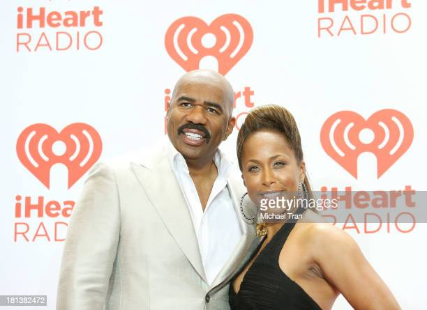 Steve Harvey and Marjorie Bridges arrive at the iHeartRadio Music Festival press room held at MGM Grand Arena on September 20 2013 in Las Vegas Nevada