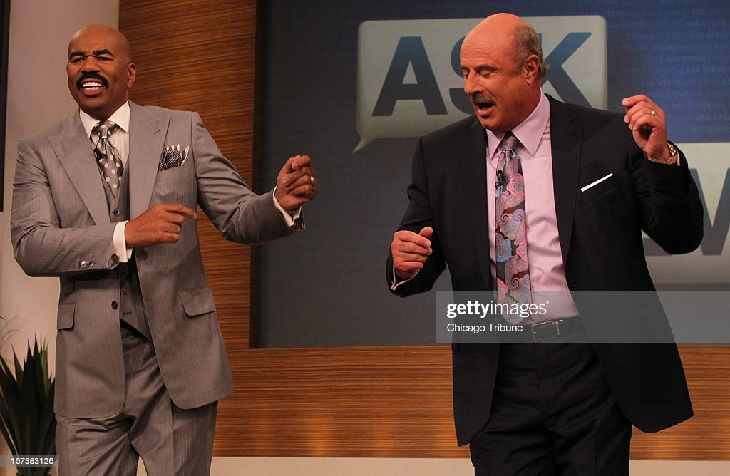 Steve Harvey, left, dances with Dr. PHil during a taping of Harvey's show in Chicago, Illinois, on April 23, 2013.