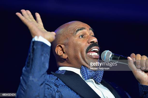 Steve Harvey speaks at the 2015 Ford Neighborhood Awards Hosted By Steve Harvey at Phillips Arena on August 8 2015 in Atlanta Georgia