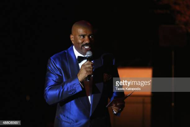 Steve Harvey speaks onstage at the 2014 Steve Marjorie Harvey Foundation Gala presented by CocaCola at the Hilton Chicago on May 3 2014 in Chicago...