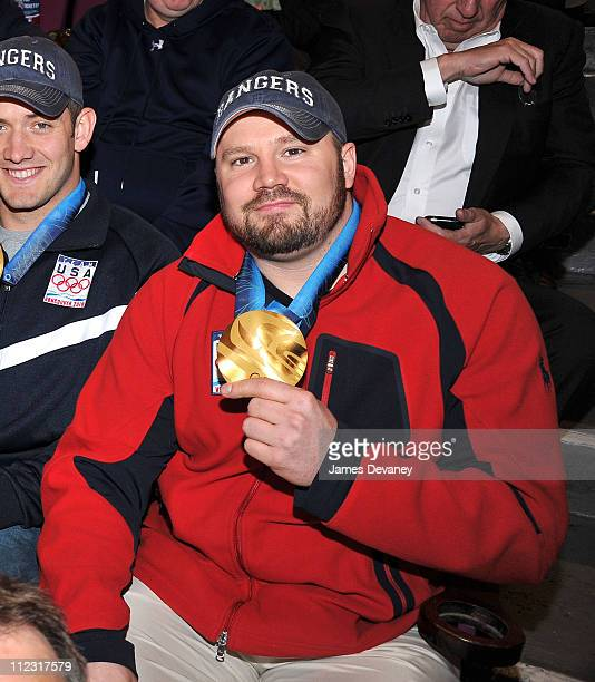 Steve Holcomb of the USA Olympic Bobsled team attends the Pittsburgh Penguins Vs New York Rangers game at Madison Square Garden on March 4 2010 in...