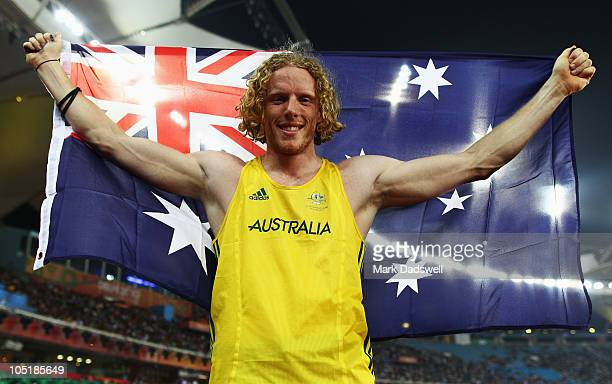 Steve Hooker of Australia celebrates winning gold in the men's pole vault at Jawaharlal Nehru Stadium during day eight of the Delhi 2010 Commonwealth...