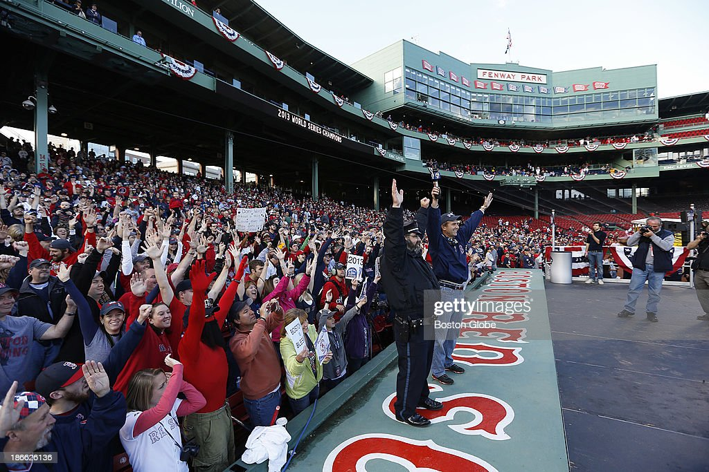 Steve Horgan, the now famous bullpen cop, posed with news anchor Jonathan Hall of Channel 7. The Red Sox Rolling Rally started at Fenway Park and paraded around Boston after the Boston Red Sox won the 2013 World Series, on Saturday, Nov. 2, 2013.