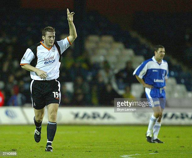 Steve Howard of Luton Town celebrates scoring during the FA Cup First Round Replay match between Luton Town and Thurrock on November 18 2003 at...