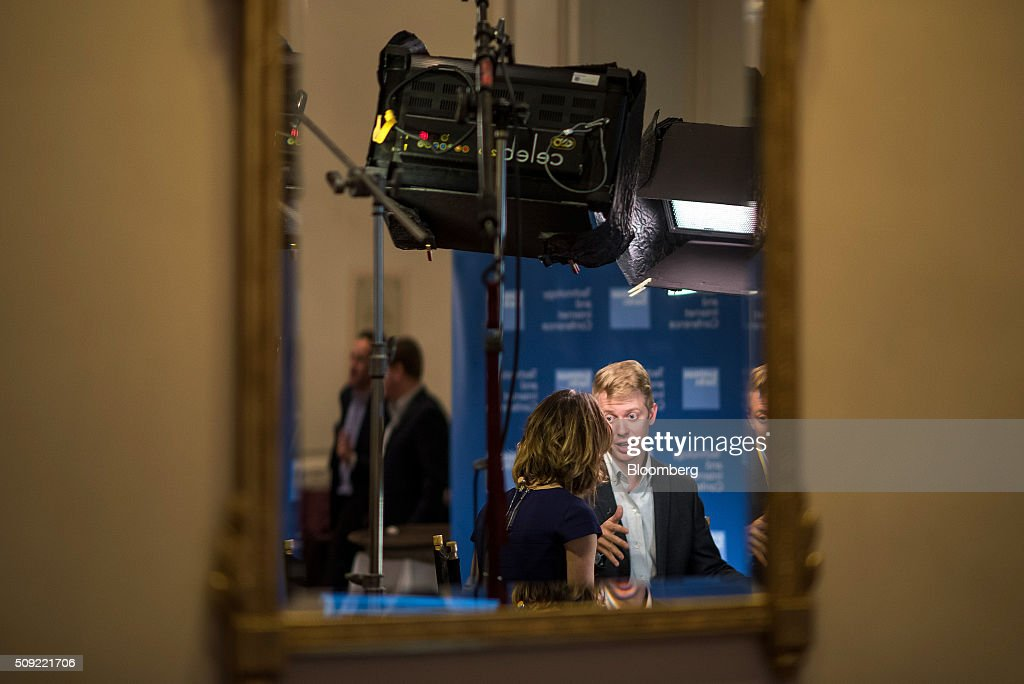Steve Huffman, co-founder and chief executive officer of Reddit Inc., right, is seen reflected in a mirror while speaking during a Bloomberg Television interview at the Goldman Sachs Technology and Internet Conference in San Francisco, California, U.S., on Tuesday, Feb. 9, 2016. Huffman discussed the company's business strategy. Photographer: David Paul Morris/Bloomberg via Getty Images