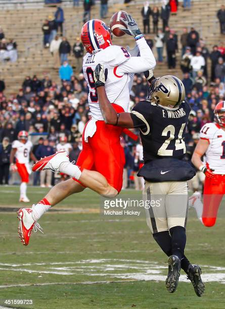 Steve Hull of the Illinois Fighting Illini goes up for a pass reception as Frankie Williams of the Purdue Boilermakers defends at RossAde Stadium on...