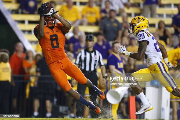 Steve Ishmael of the Syracuse Orange catches the ball for a touchdown as Andraez Williams of the LSU Tigers defends during the second half of a game...