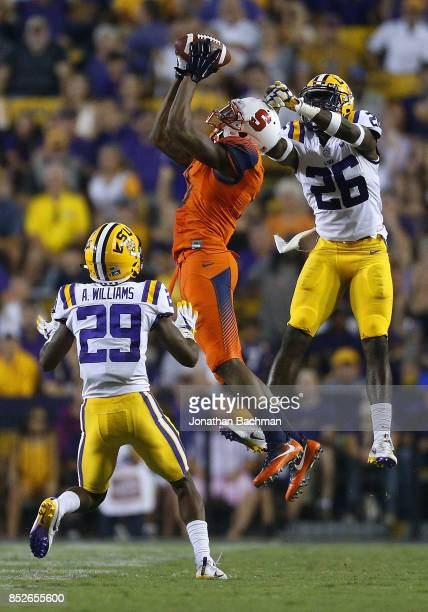 Steve Ishmael of the Syracuse Orange catches the ball over John Battle of the LSU Tigers and Andraez Williams during the second half of a game at...